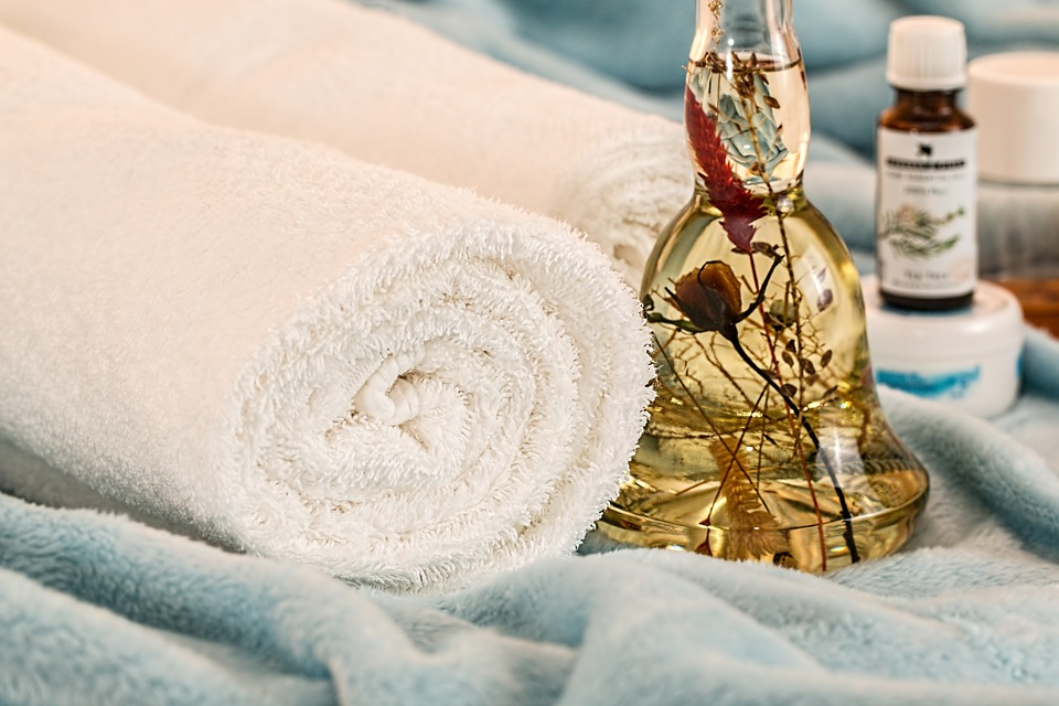 a towel with an ointment oil for massage therapy.